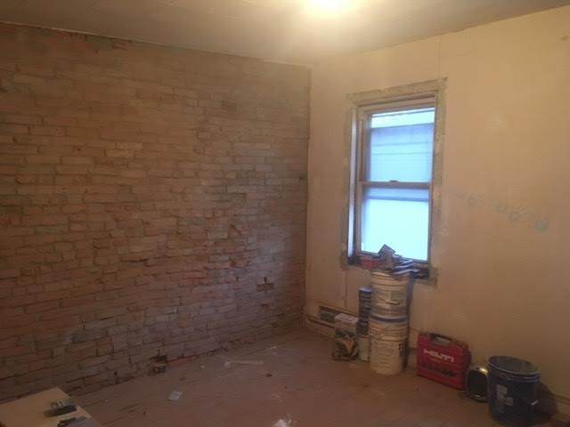 #1 Untreated Exposed Brick Wall (Front Bedroom)